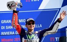Movistar Yamaha MotoGP's Spanish rider Jorge Lorenzo celebrates his third place on the podium of the San Marino Moto GP Grand Prix race at the Marco Simoncelli Circuit in Misano, on September 11, 2016.  / AFP PHOTO / GIUSEPPE CACACE